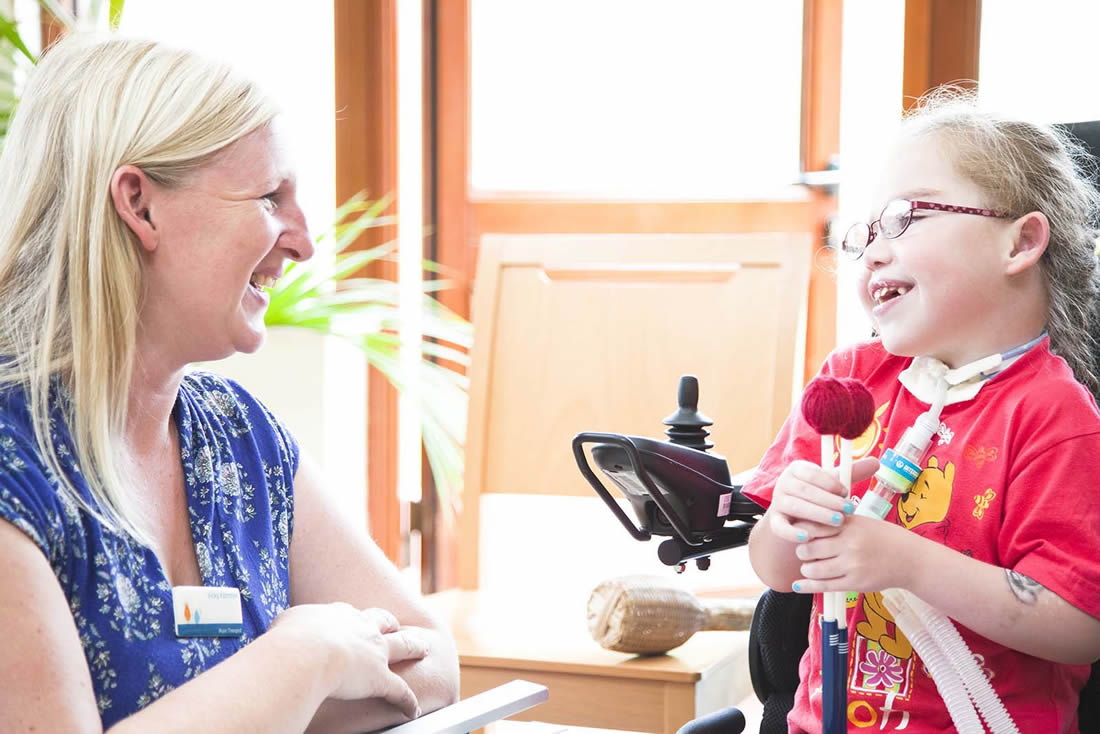 Volunteer and Child at Shooting Star Chase Hospice, Guildford / Hampton