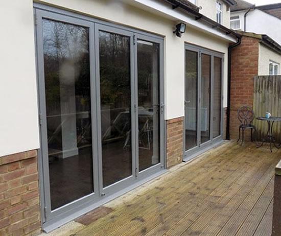 Metallic Bi-Fold Doors - Supply & Fitting by GHI Windows of Weybridge Surrey