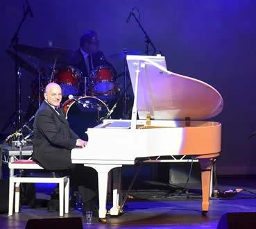 At the Piano -Comedy & Music at Bobby Davro Comedy Gala at New Victoria Theatre Woking Surrey
