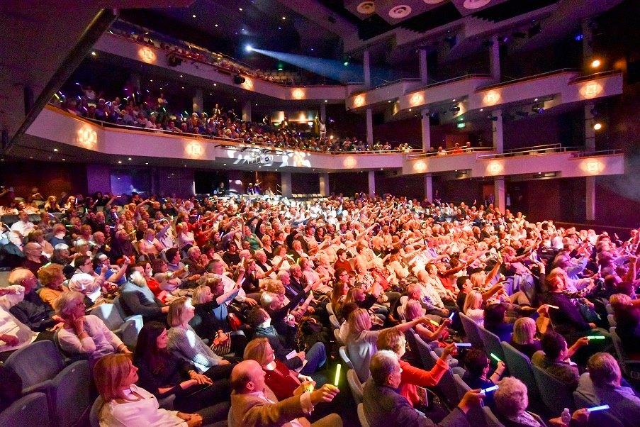 Full Theatre in Woking enjoying Booby Davros' Comedy Spectaular Fundraiser for Woking & Sam Beare Weybridge Hospices