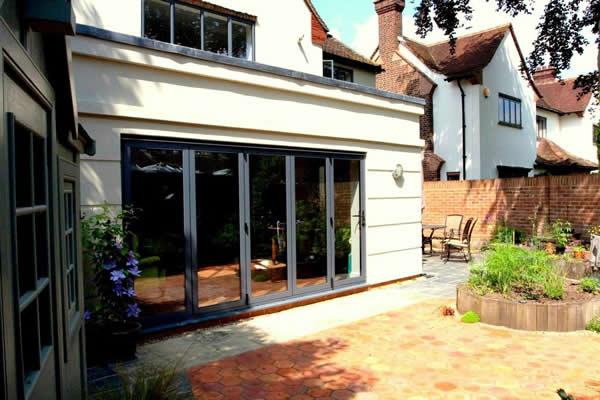 Extension including Bi-Fold Doors by Weybridge Builders Wye Construction Services Weybridge Surrey