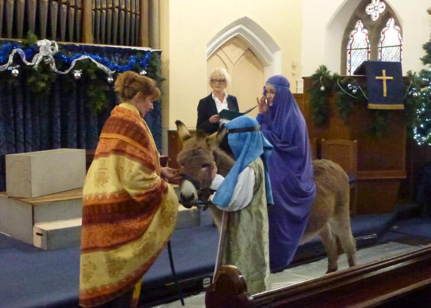Nativity story and real donkey at Christmas Eve Crib Church Service Weybridge Surrey