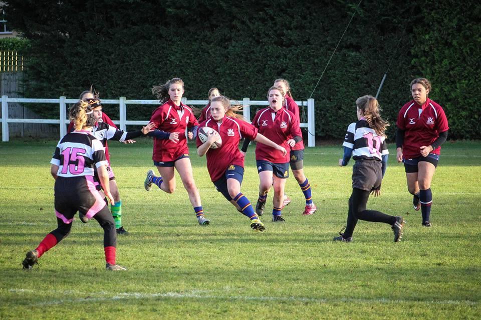 Girls having fun playing rugby at Cobham Bluebirds Club in Elmbridge Surrey