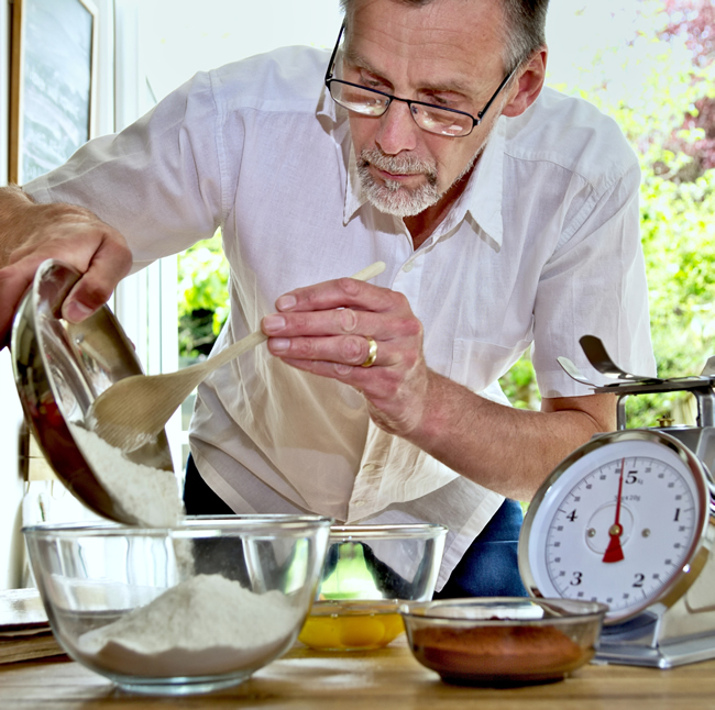 Man Baking for Great Weybridge Cake Off Competition on Monument Green