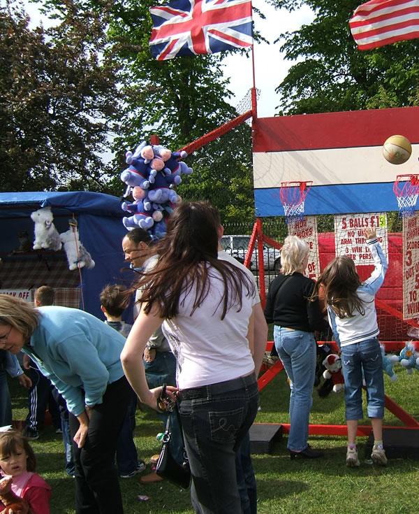 Basket Ball Fun at Oatlands Village Fair near Walton On Thames Elmbridge Surrey