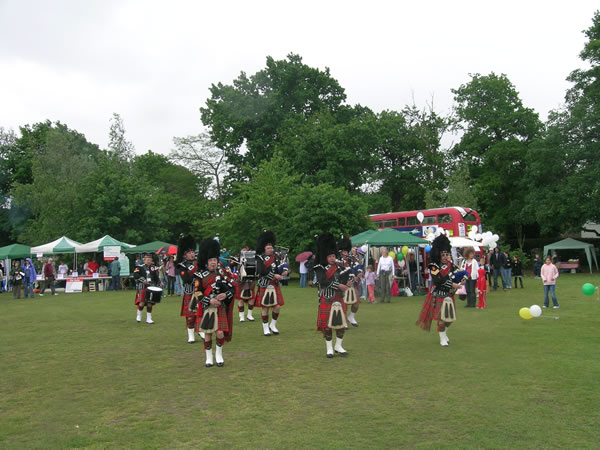 Oatlands Pipe Band will be opening Oatlands Village Fair near Walton On Thames Elmbridge Surrey