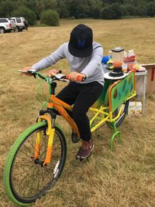 Child cycling on Smoothie Bike at Brooklands Fun Day Weybridge Surrey