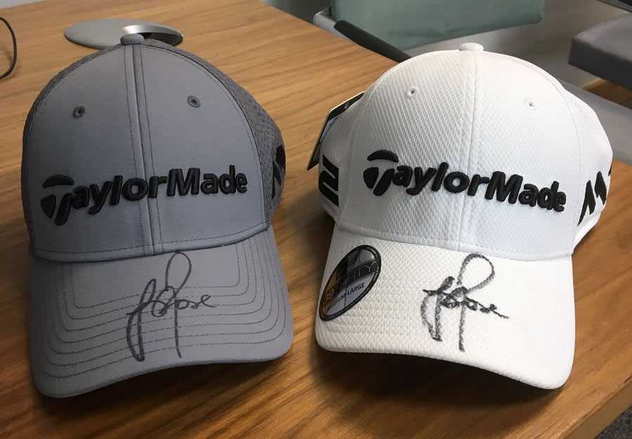World Famous Golf Star Justin Rose has donated these signed baseball caps as prizes  in the raffle at the charity Quiz in Weybridge