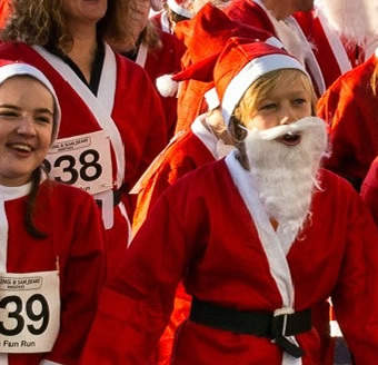 Kids running in Santa Fun Run - Woking & Sam Beare Hospices Charity FUNdraiser!