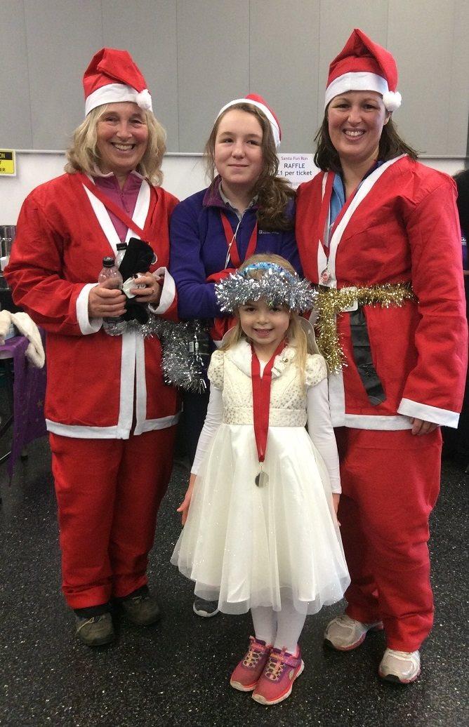 Familt at Santa Fun Run for Woking & Sam Beare Weybridge Hospices