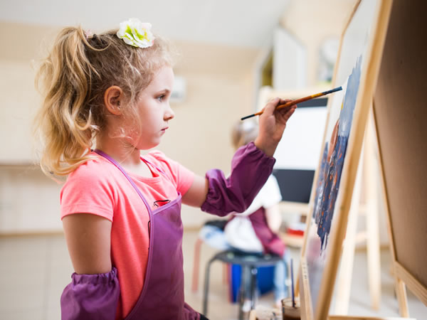 Child Painting in Art Class - Walton on Thames Elmbridge Surrey - Studio at Riverhouse Barn