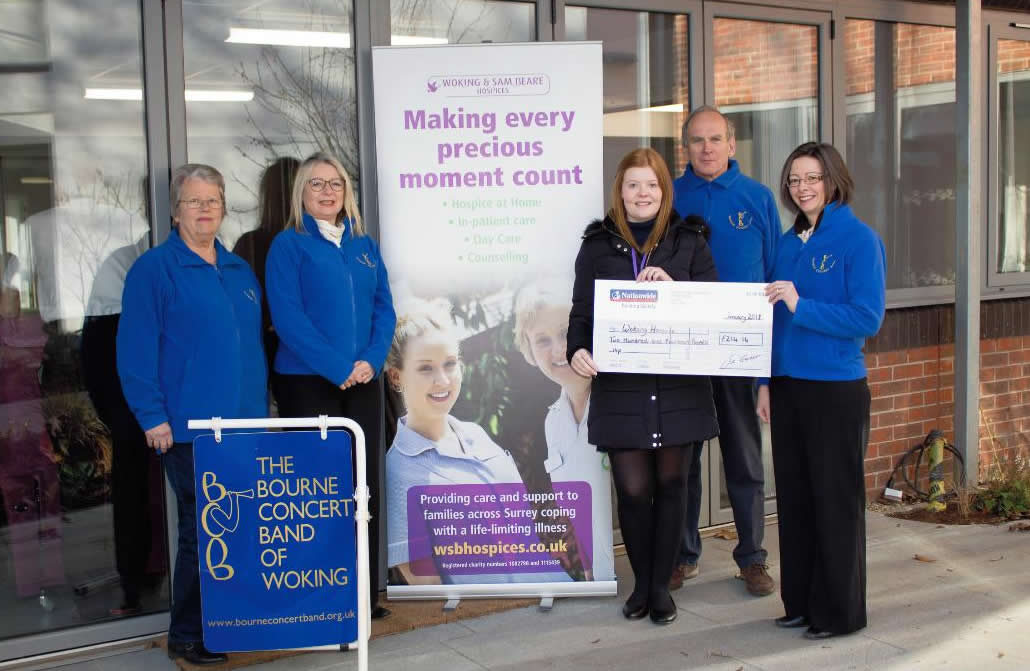 Bourne Concert Band Donate Charity Cheque to Woking and Sam Beare Hospices Woking