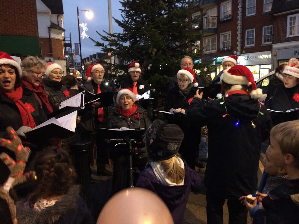 Carol Singers at Christmas Market Event Baker Street Town Center Weybridge Surrey