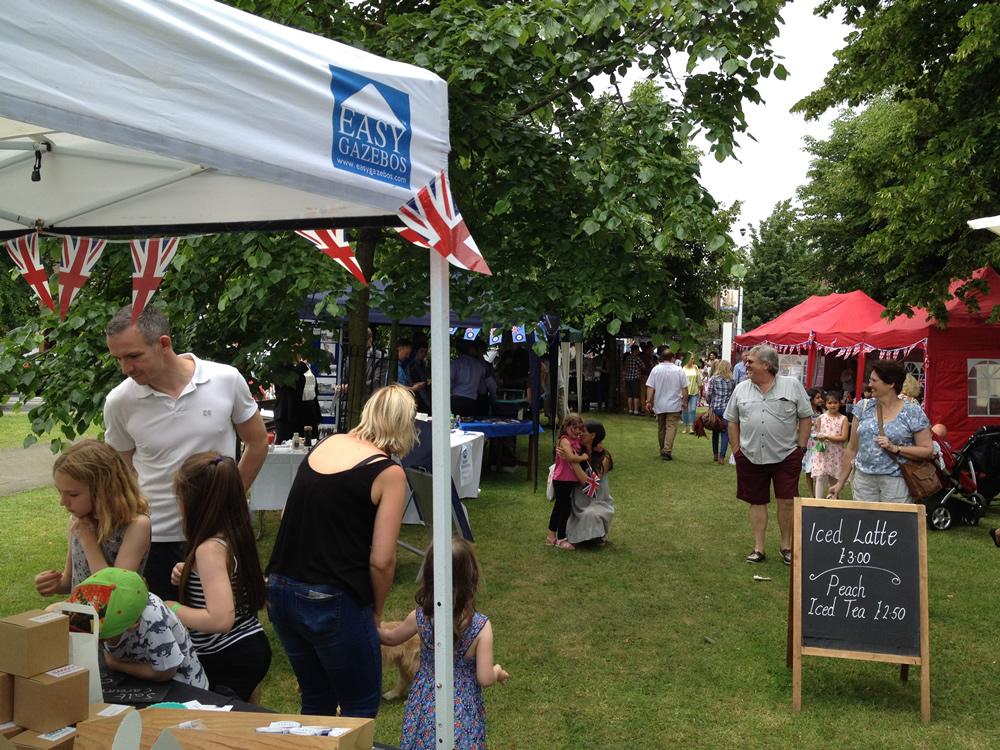 Families enjoy browsing market stalls at Weybridge Town Business Group summer event