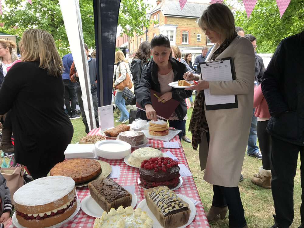 Great Weybridge Cake Off Judges Ruth Langsford TV Celebrity and Gemma Woods from The Kitchen Shop taste the cakes