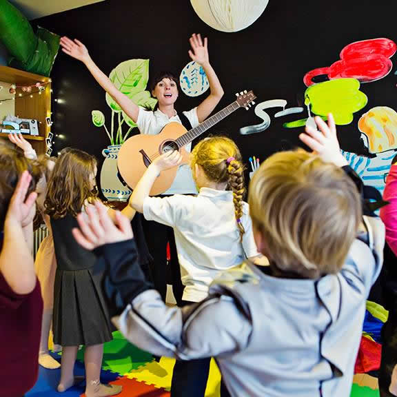 Music Classes and Parties For Young Children by Lucy Sparkles - Sessions in Weybridge Scout Hut
