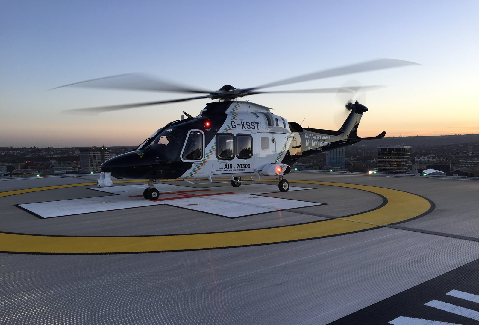 Kent, Surrey & Sussex Air Ambulance -AW169 Bristol Royal Infirmary Helipad Stationary Day