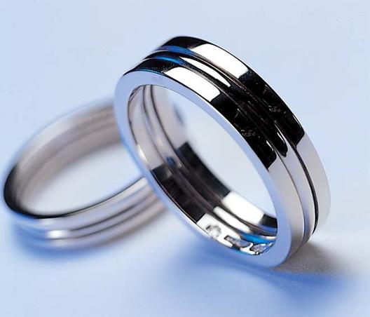 Three section platinum rings  by Jon Dibben