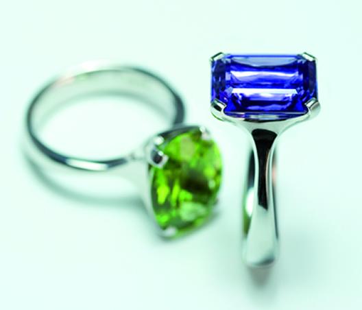 Octagonal cut tanzanite and oval peridot set in platinum  by Jon Dibben