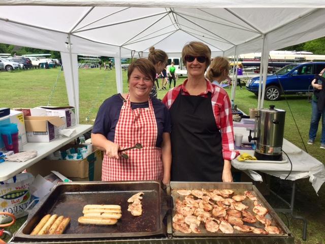 Friendly Ladies Serving Food at the Barbeque - Ladies Rowing Club Regatta in Weybridge Surrey