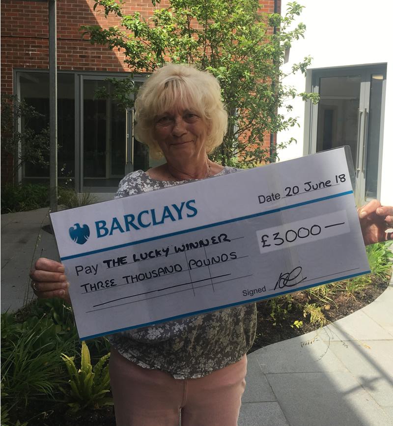 Woking & Sam Beare Hospices Raffle - £3,000 Winner Denise from Horsell